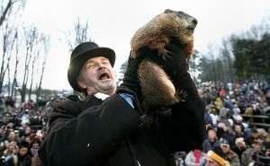 Groundhog Handler John Griffiths holds up famed weather prognosticating groundhog Punxsutawney Phil after his annual prediction on Gobbler's Knob in Punxsutawney, Pennsylvania
